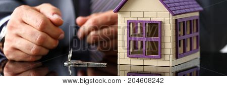 Man In Suit And Tie And Silver Key Closeup