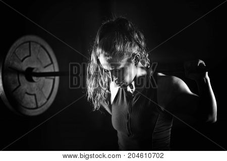 Woman Weightlifting On Training, Black And White Image, Black Background