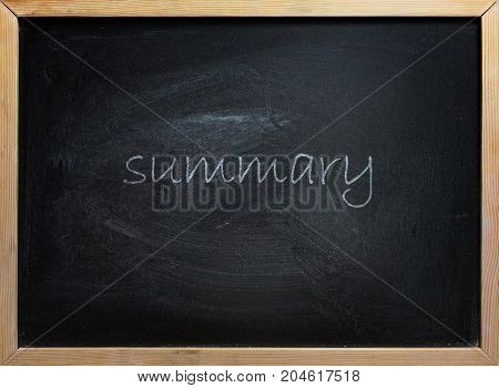Summary text written on black school board with wooden frame.
