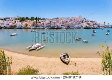 Small boats in harbor of village at coast