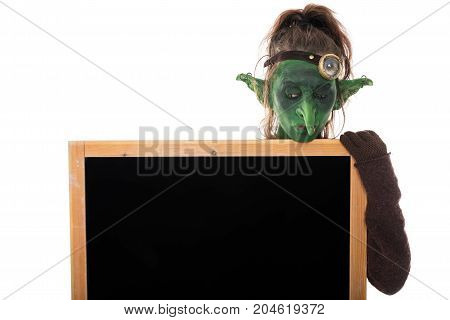 Little Goblin Holding A Big Slate With Copyspace