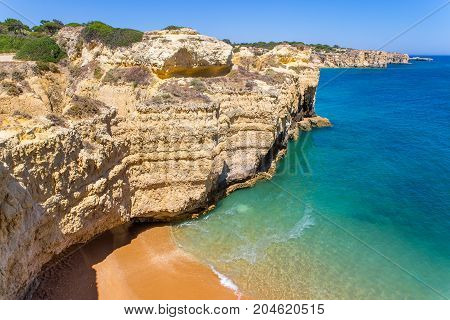 Rocky mountains with blue sea at coast in portugal