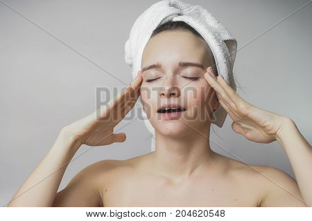 Woman doing facial massage and enjoys soft clean skin