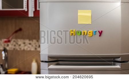 Empty Paper Sheet On Refrigerator Door With Magnetic Clip Paper Note For Add Text Message. Hungry
