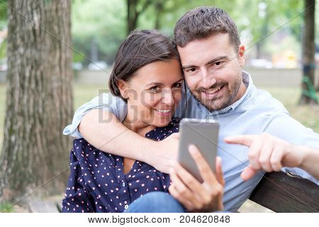 Lover Couple Watching Media Content On Mobile Phone