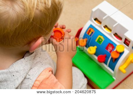 Child Learning To Count By Playing With Toy Till