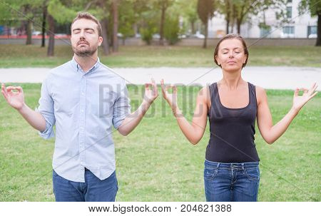 Profile Of A Couple Of Man And Woman Meditating In The Nature