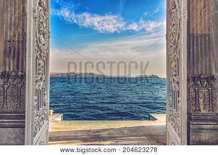 ISTANBUL, TURKEY: Dolmabahce Palace Gate leading to the Bosphorus Strait. Istanbul, Turkey on October 7, 2014