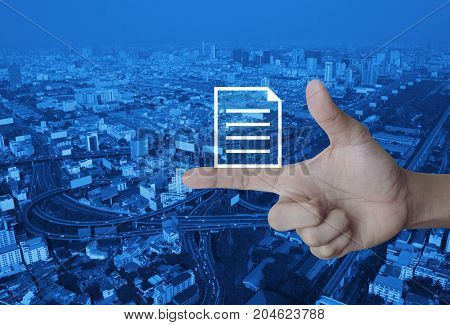 Document icon on finger over modern city tower street and expressway Business communication concept