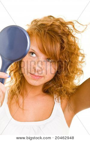 Woman Viewing Herself In Mirror