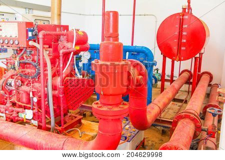 pipe system Old big plumbing red which has dust dirty inside of building industrial