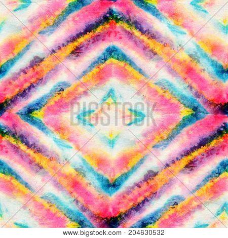 Seamless tie-dye pattern of bright color on white silk. Hand painting fabrics - nodular batik. Shibori dyeing.