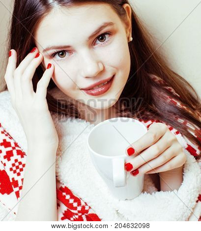 young pretty brunette girl in Christmas ornament blanket getting warm on cold winter, freshness beauty concept, lifestyle people concept close up