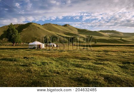 Two yurts at the green Mongolian steppe