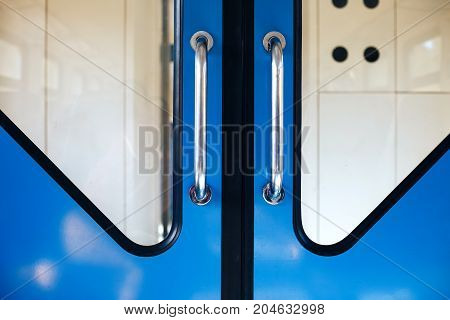 Metallic Blue Doors In The Train Between The Cars Copy Space