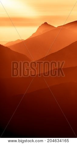 An Inspiring Mountain Landscape In Tatry, Slovakia. Vivid, Gradient Scenery With Perspective In Red