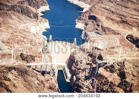 Hoover Dam is a concrete arch-gravity dam in the Black Canyon of the Colorado River, on the border between the U.S. states of Arizona and Nevada.