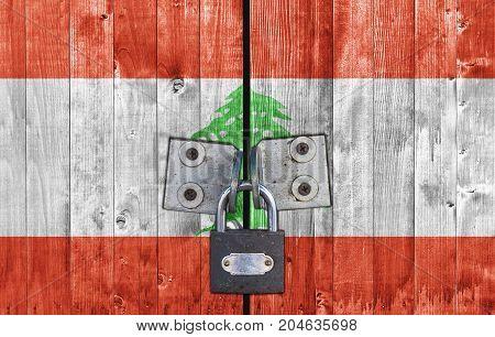 Lebanon flag on door with padlock close