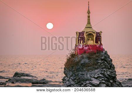 Sunset falls over a amall Pagoda at Chaung Thar Beach (Myanmar)