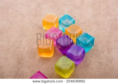 Fake Colorful Ice Cubes  On Wood