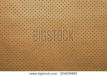 Yellow perforated leather texture background abstract dots