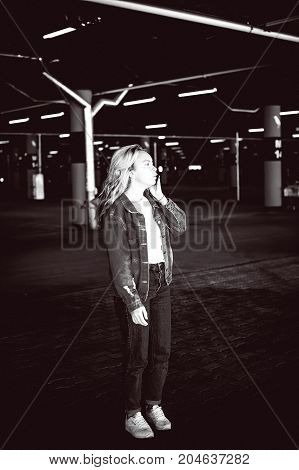 Young Beautiful Woman In Jeans Clothes In Parking Of Shopping Center. Portrait Of A Girl With Freckl