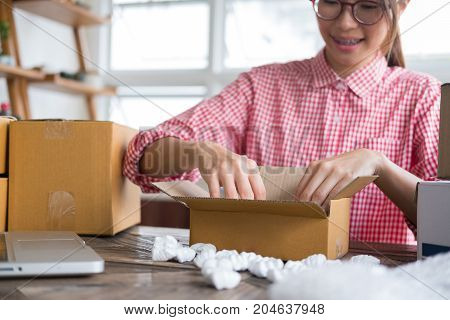Start Up Small Business Owner Packing Cardboard Box At Workplace. Freelance Woman Entrepreneur Sme S