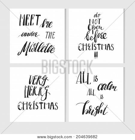 Hand made vector abstract Merry Christmas greeting cards set with elegant ink modern calligraphy phases and quotes isolated on white background.Happy New Year concept.