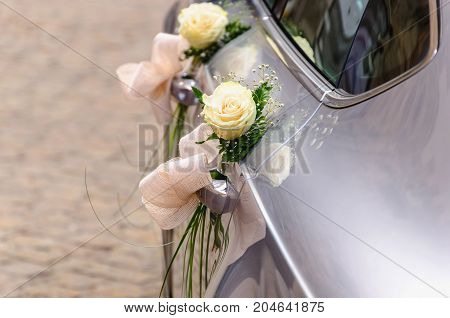 Wedding Car Decorated With White Roses Ready To Carry Just Married Direct To Honeymoon