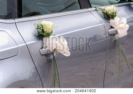 Wedding Car Decorated With White Roses
