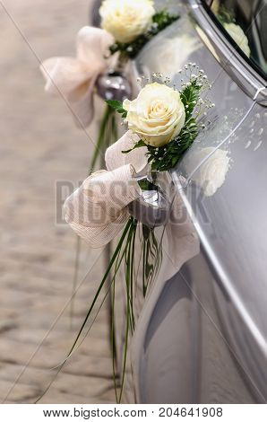Wedding Car Decorated With White Roses Ready To Carry Just Married Couple To Honeymoon