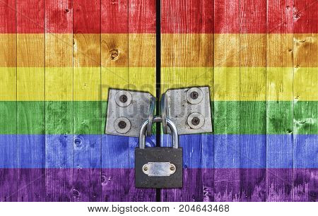 LGBT flag on door with padlock close