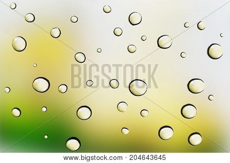Water drops on glass background over colored bokeh