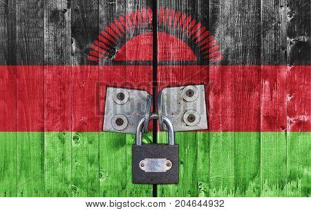 Malawi flag on door with padlock close