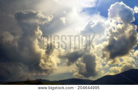 The sun overcomes the clouds. Weather changes in mountains
