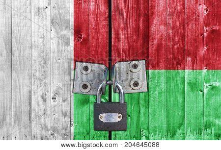 Madagascar flag on door with padlock close