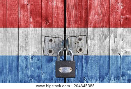 Luxembourg flag on door with padlock close