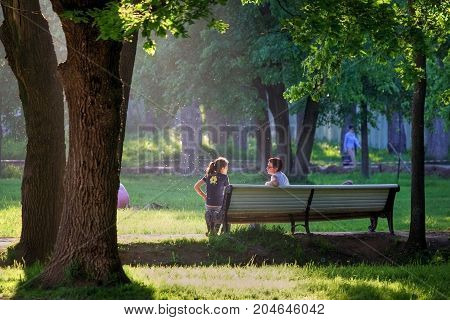 Russia, Moscow - Summer 2008: Two women sit on a bench in the park in the summer