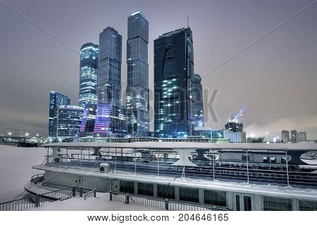 Skyscrapers and steamship in the winter in Moscow