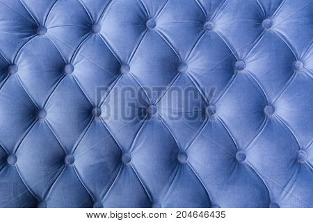 Blue fabric sofa texture with buttons for background and design