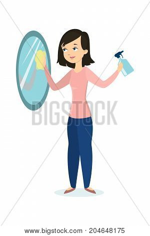 Isolated woman cleaning mirror on white background.