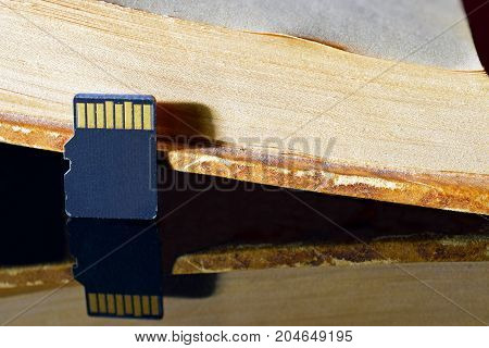 Micro sd memory card and old book