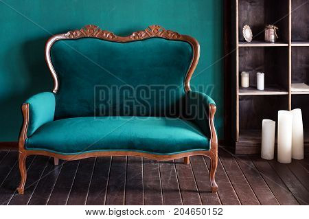 Antique wood sofa couch in vintage room. Classical style armchair
