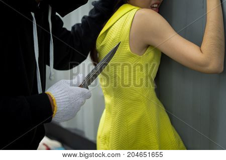 Bandit man holding knife to hijack hostage woman