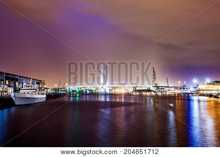 A beautiful view of docklands and The Bolte Bridge with a cloudy sky and twilight in Melbourne Australia.