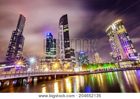 A view across the Yarra river atthe landmark of Melbourne downtown during the city's nightime.