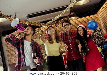 Young men and women group christmas party together with dancing drinking wine happy and fun in new year cerebrate