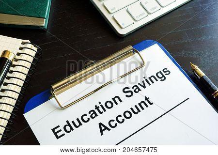 Education savings account ESA form in a clipboard.