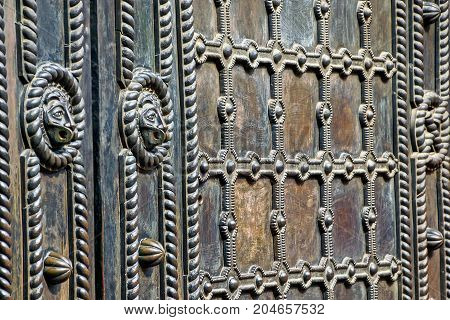 metal texture of a fragment of an old gate