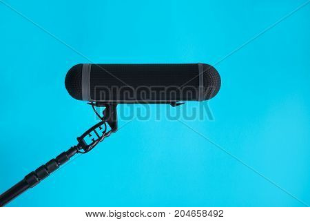 Sound recorder microphone boom mic on blue background